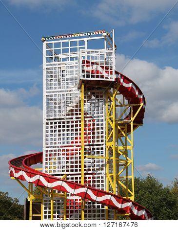 A Helter Skelter Ride at a Fun Fair Amusement Park.