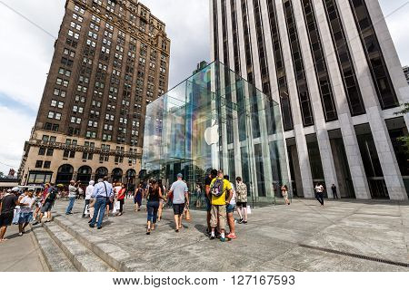 NEW YORK - AUGUST 23, 2015: View to the Apple Store building at day on August 23, 2015. This is one of the most profitable Apple shops worldwide located at the Fifth Avenue in Manhattan.