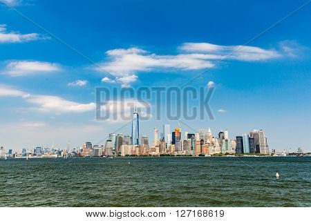 NEW YORK - AUGUST 24: Views of Midtown Manhattan from Liberty Island side on August 24 2015. This park provides a beautiful view to the Manhattan skyline.