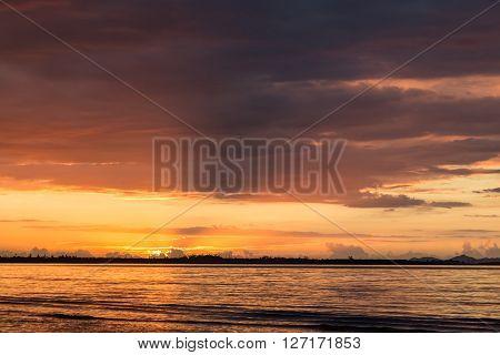 Fantastic pink sunset on the ocean beach. Fiji.