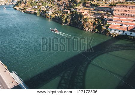Top view of the Douro river with the shadow of Eiffel bridge in Porto Portugal