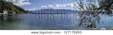Typical wide view of the shores of Garda Lake (Lombardy, Northern Italy), early springtime. Color image.