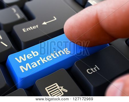 Web Marketing Blue Button - Finger Pushing Button of Black Computer Keyboard. Blurred Background. Closeup View. 3D Render.