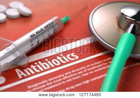 Antibiotics - Printed Diagnosis on Orange Background and Medical Composition - Stethoscope, Pills and Syringe. Medical Concept. Blurred Image. 3D Render.