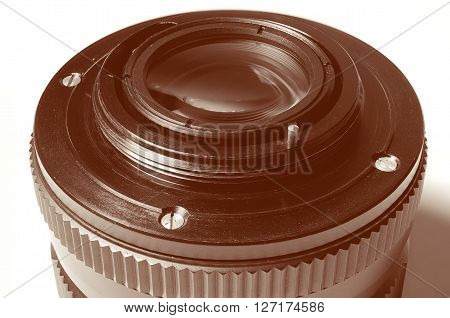 Old film DSLR lens. Metal bayonet, screw and pin aperture. Close up view. Macro. Vintage photo toning.