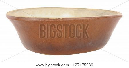 Old rustic glazed earthenware pie dish isolated on a white background