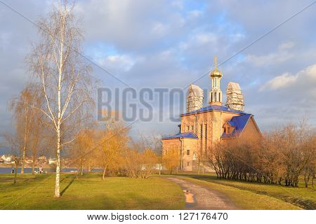 Park in Rybatskoe and The Church of the Nativity of the Blessed Mary at early spring in St.Petersburg Russia.