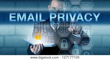 Security manager is pressing EMAIL PRIVACY on a touch screen interface. Information technology metaphor and data protection concept for authorized access to electronic mail.