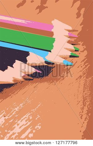 close up colored pencils on wooden plate background