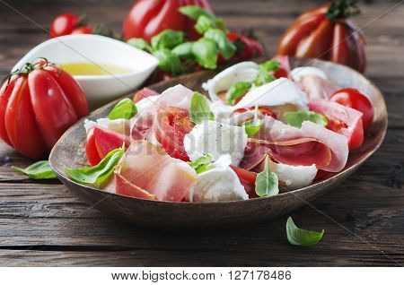 Italian Salad Caprese With Ham And Mozzarella