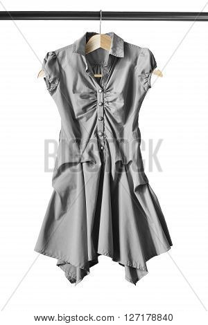 Gray dress on clothes rack isolated over white