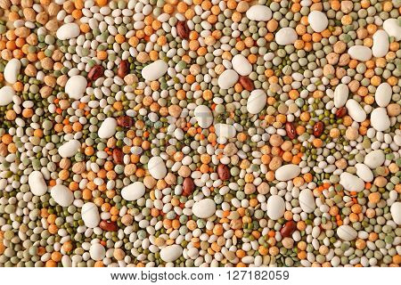 Variety of coloured beans and lentils. Food background.
