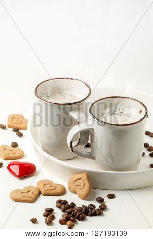 Tow Cup Of Cappuccino With Cookies As Hearts