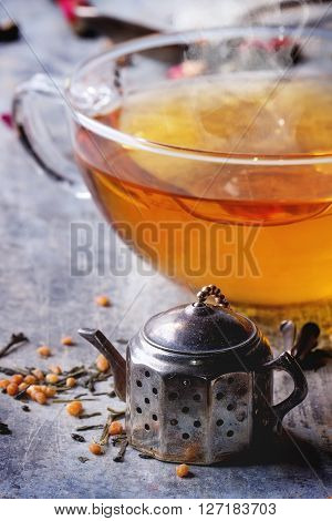 Cup Of Hot Tea With Teastrainer