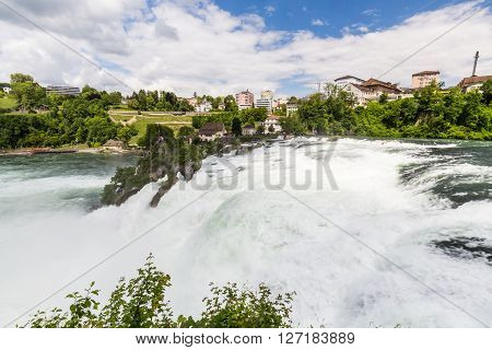 RHEINFALLS, SWITZERLAND - MAY 17, 2015: View to the biggest waterfalls of Europe in Schaffhausen Switzerland on May 17 2015. They are 150 m (450 ft) wide and 23 m (75 ft) high.