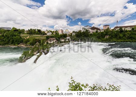 RHEINFALLS SWITZERLAND - MAY 17: View to the biggest waterfalls of Europe in Schaffhausen Switzerland on May 17 2015. They are 150 m (450 ft) wide and 23 m (75 ft) high.