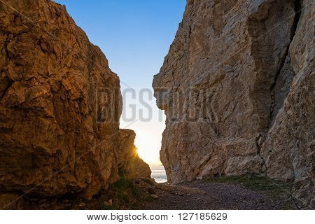 Rock formations at sunset on a beach of Kos island, Greece