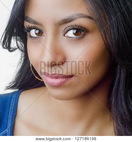 Attractive young woman closeup photo of her face