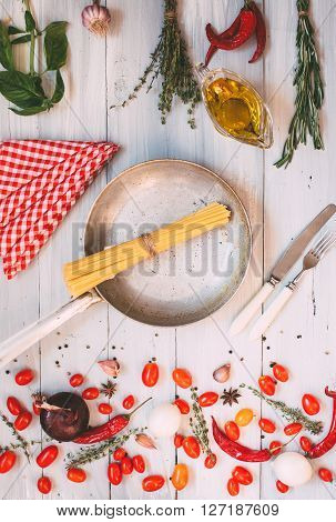 Cooking flat lay. Spaghetti. Italian food. Pasta spaghetti vegetables and spices on wooden table. Italian food.