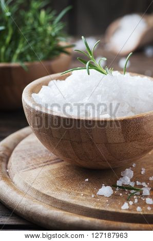 White Salt And Green Rosemary On The Wooden Table