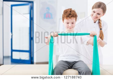 Boy And Physical Therapy In Clinic