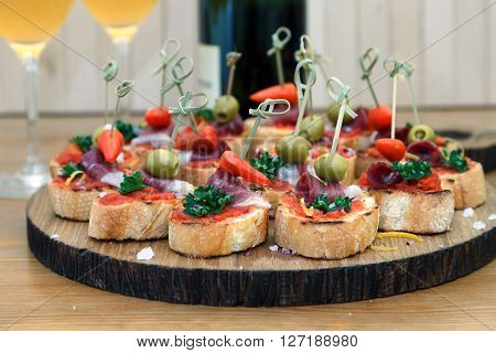 Tapas on Crusty Bread - Selection of Spanish tapas served on a sliced baguette