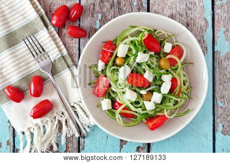 Fresh Greek Salad With Cucumber Noodles, Overhead Scene On Rustic Wood Background