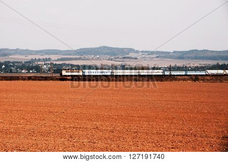Train with wagons and field in the move