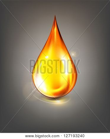 golden drop of oil on a gray background(JPEG Version)