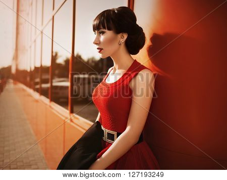 Portrait of beautiful young woman with makeup in fashion clothes