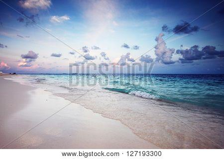 Sunrise on tropical sandy beach