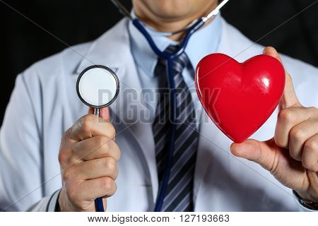 Male Medicine Doctor Wearing Hold In Hands Red Toy Heart