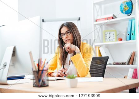 Beautiful businesswoman working on computer in office