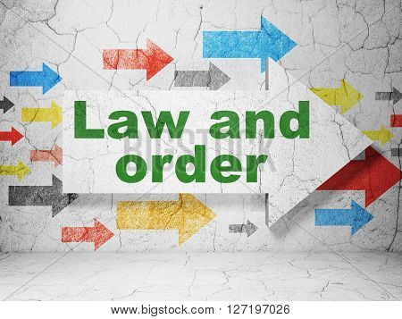 Law concept:  arrow with Law And Order on grunge textured concrete wall background, 3D rendering