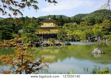 KYOTO, JAPAN - APRIL 16 2016: Kinkakuji view with reflection on pond, Kinkakuji (golden pavilion temple) is the most well-known Zen Buddhist temple in Kyoto