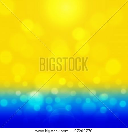 Summer background with yellow bokeh. Sea and sand glisten in the sun