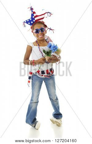 A young elementary girl all decked out for Independence Day.  On a white background.