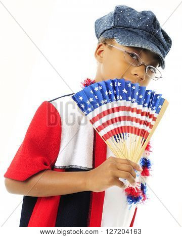 A young elementary girl fanning herself and dressed in red, white and blue.  On a white background.