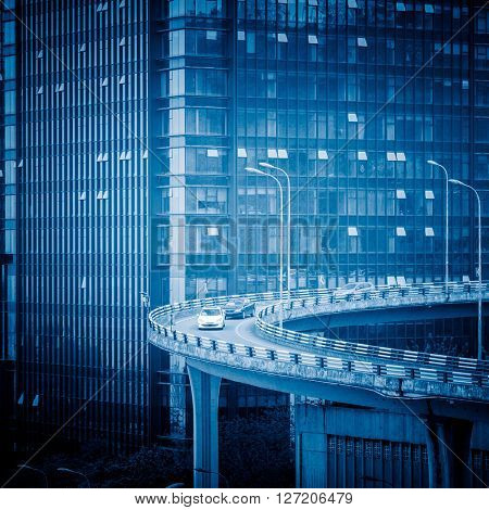 urban curved viaduct of chongqing,blue toned image.