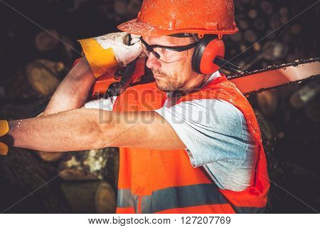 Lumber Worker. Men with Wood Cutter Wearing Safety Helmet