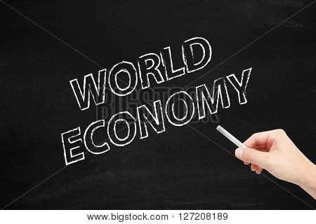 World economy written on a blackboard