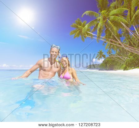 Couple with Scuba Gear in Paradise Concept