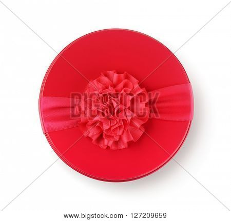 Top view of round gift box with ribbon isolated on white