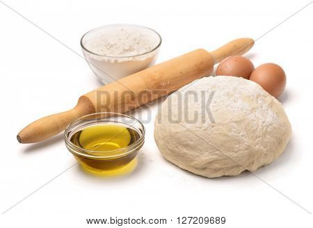 Dough with flour, olive oil, eggs and rolling pin isolated on white