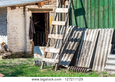 Outbuildings in the yard on a sunny day .