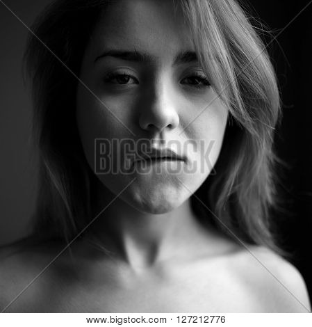 Girl bite lip like pornstar. Black and white portrait