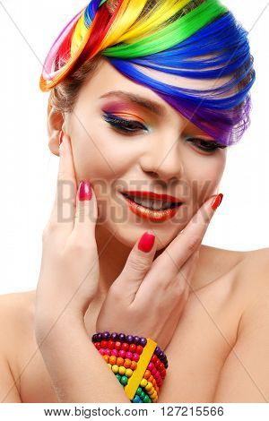 Beautiful girl with colorful makeup, manicure and hairstyle on white background