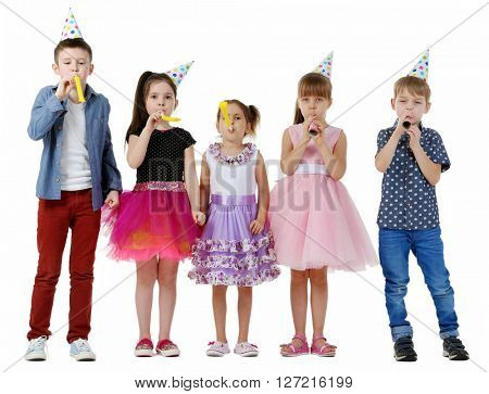 Happy group of children with noise makers having fun at birthday party, isolated on white