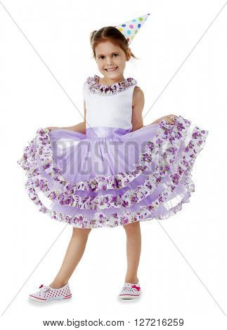Little cute girl in birthday cap and purple dress, isolated on white