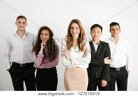Portrait of young people against white wall background